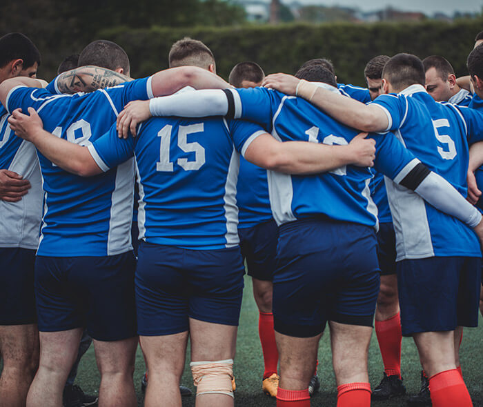 Mens sports team huddle